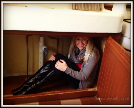 A Christmas Story House Erin under the sink mommy on the spot